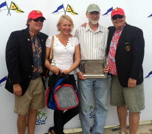 "Dave Angers, holding trophy plate, and his ""Miss Demeanor"" were 3rd in the J/80 fleet."