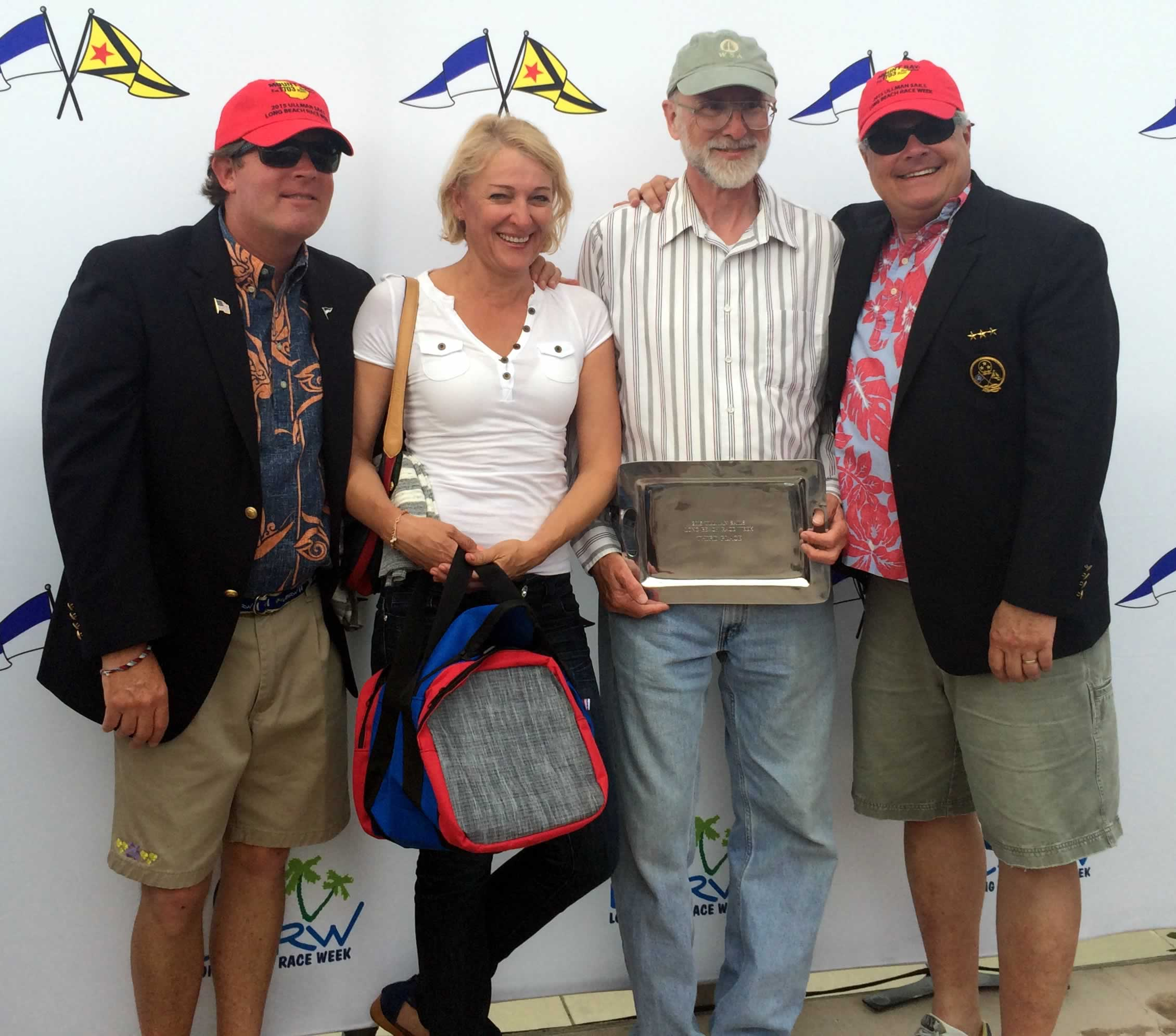"""Dave Angers, holding trophy plate, and his """"Miss Demeanor"""" were 3rd in the J/80 fleet."""
